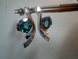 Sterling Silver Earrings by Frank Reubel